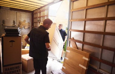 Loading furniture into removal truck