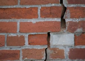 bricks showing broken foundation of house