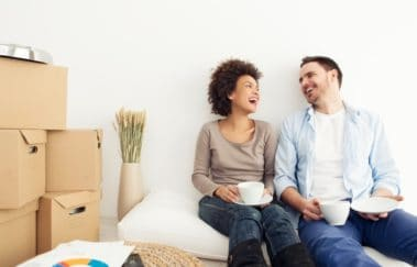 man and woman laughing in rental apartment