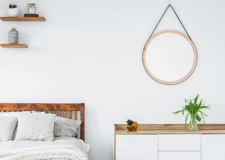 circle mirror in staged bedroom