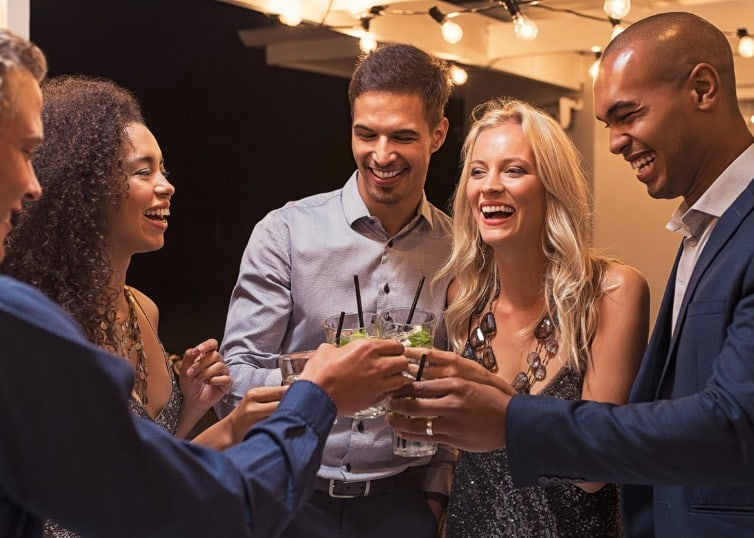 friends toasting at a networking event