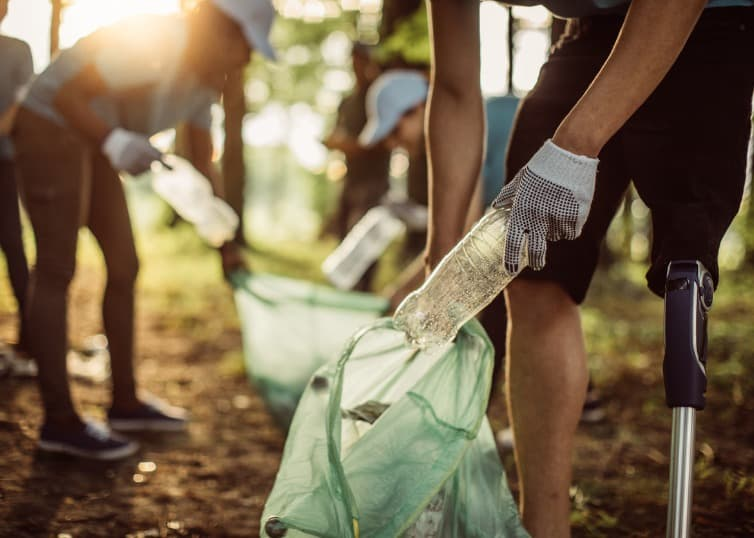 volunteers picking up trash in a park