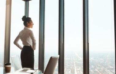 business woman looking out over the city