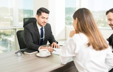 real estate agent giving couple listing presentation