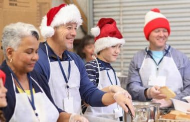 real estate agents volunteering at a food bank wearing santa hats