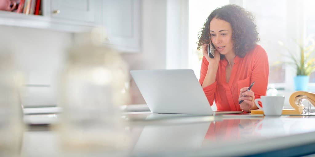 real estate agent making cold calls at table