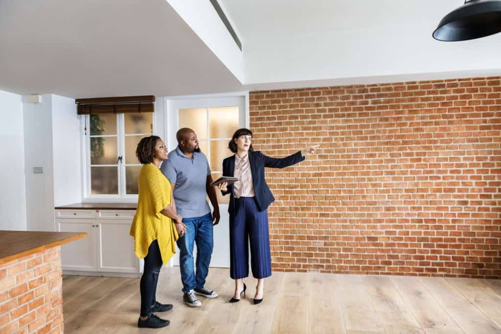 new real estate agent showing couple a house