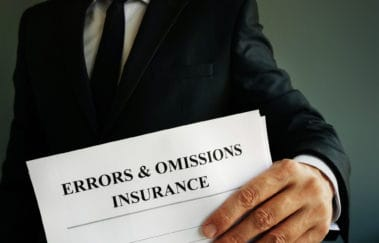 Errors and omissions E&O insurance or professional liability policy in the hands.