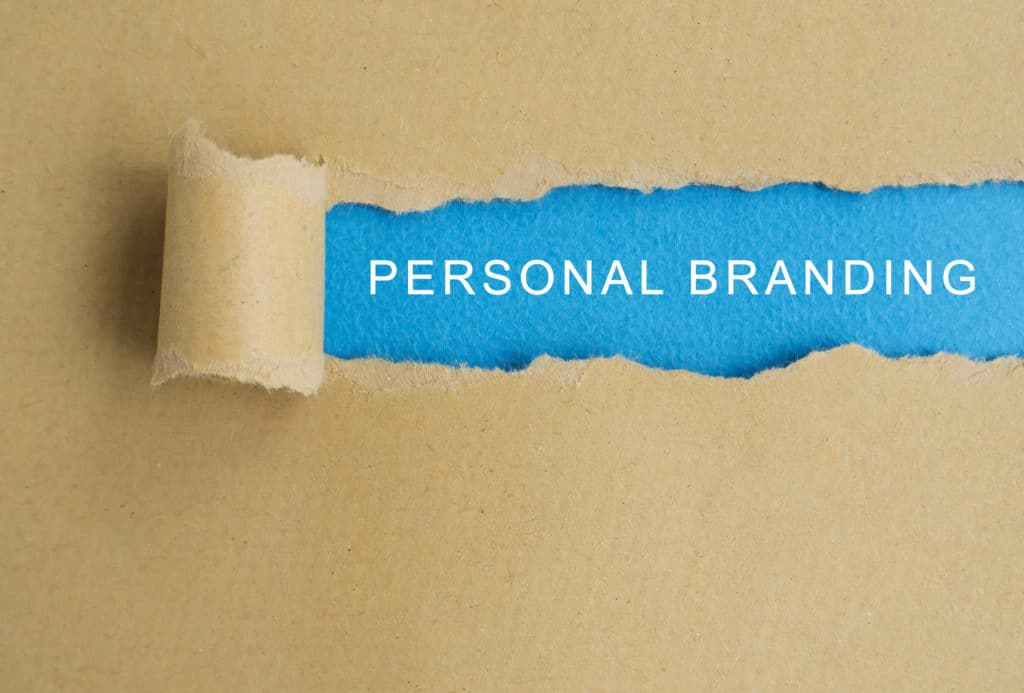 Personal branding word on torn paper