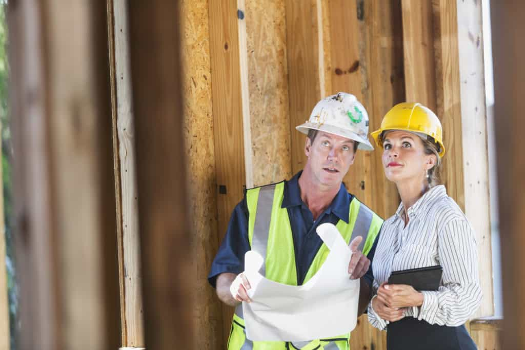 real estate agent talking to construction worker