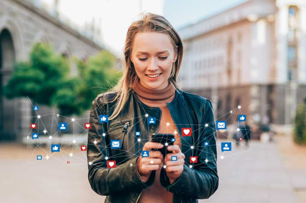 Shot of a beautiful young woman receives notifications on smart phone. Social media and digital online concept. Social media and people network technology concept.