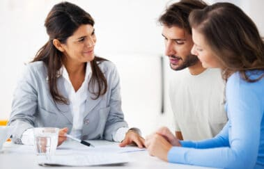 couple meeting with real estate broker