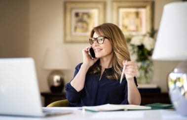 real estate agent talking to client on phone