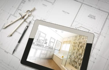 Computer Tablet with Master Bathroom Design Over House Plans, Pencil and Compass.