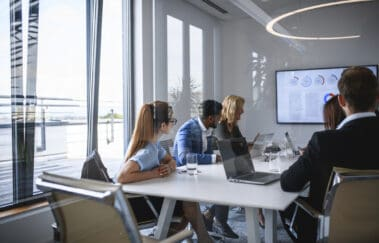 Executive Team Watching Video in Office Conference Room